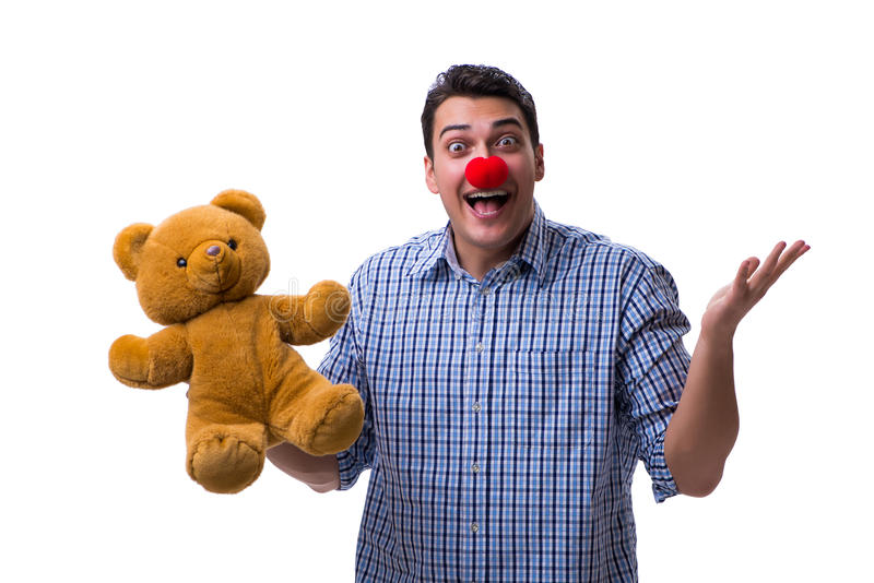 Funny clown man with a soft teddy bear toy isolated on white bac. Kground stock photography