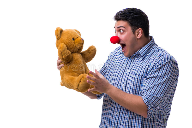 Funny clown man with a soft teddy bear toy isolated on white bac. Kground stock image