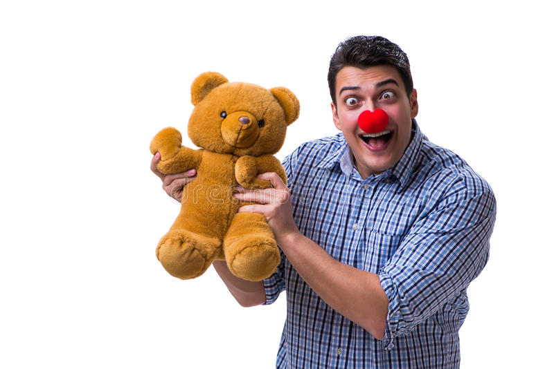 Funny clown man with a soft teddy bear toy isolated on white bac. Kground royalty free stock photos