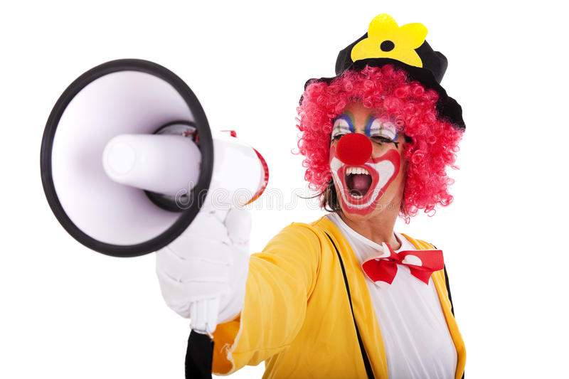 Funny clown with a megaphone royalty free stock photography