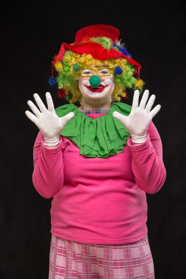 Funny clown in shiny glasses with good cheerful emotions. Funny curly clown in shiny glasses with good cheerful emotions royalty free stock photography