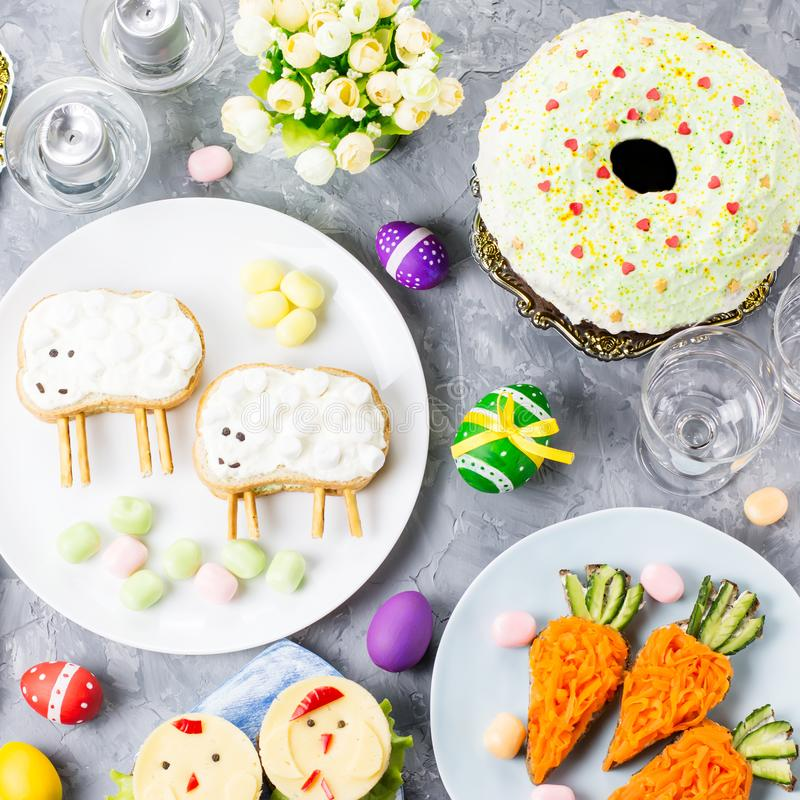 Funny colorful Easter food for kids with decorations on table. Easter dinner concept stock photos