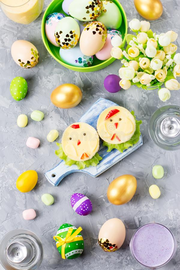 Funny colorful Easter food for kids with decorations on table. Easter dinner concept royalty free stock photos