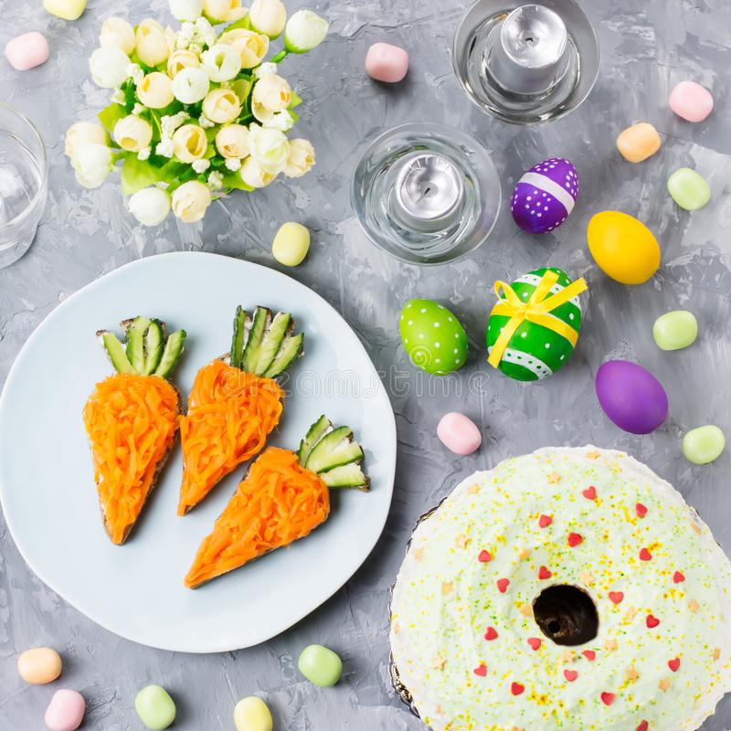Funny colorful Easter food for kids with decorations on table. Easter dinner concept. Top view stock images