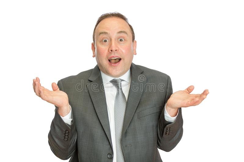 Funny, comical business man in suit shrugging royalty free stock photos