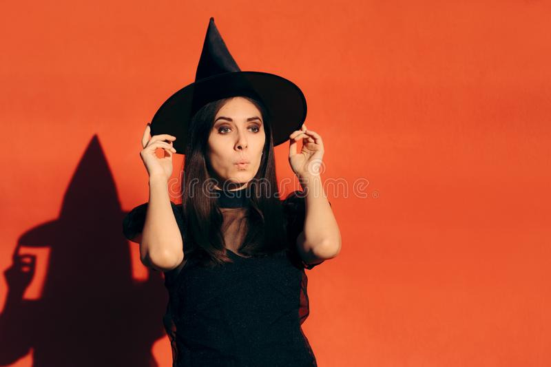 Halloween Woman in Witch Costume Outdoors Portrait stock photo