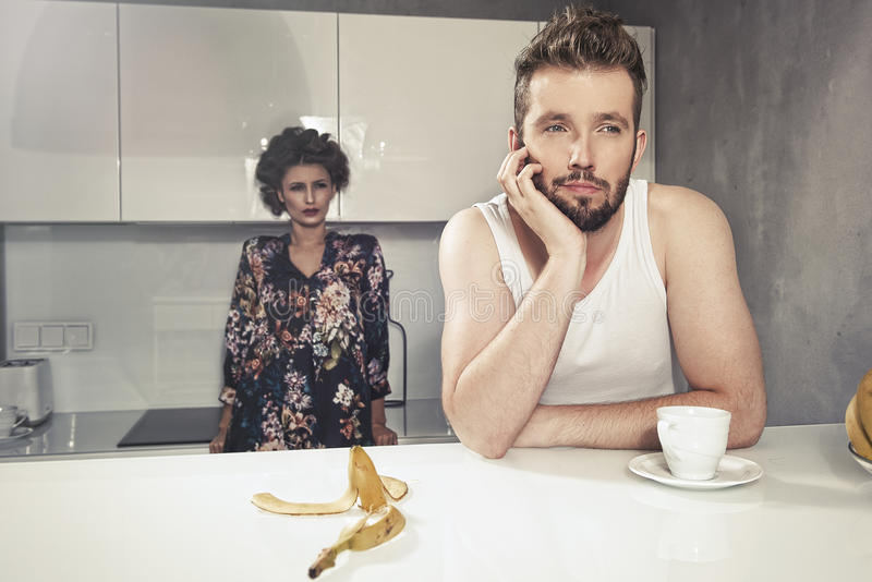 Funny couple after breakfast. Strange faces. royalty free stock photos