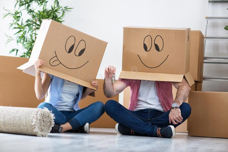 Funny couple celebrating move to new apartment royalty free stock photo