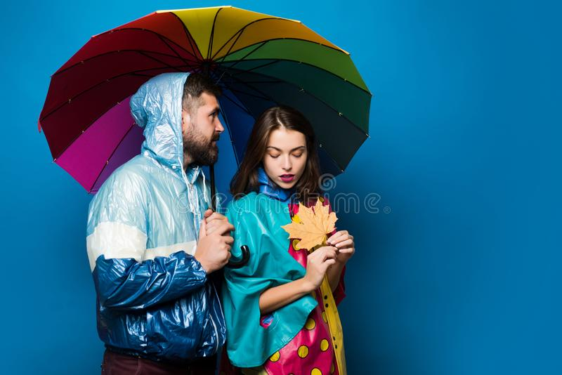 Funny couple are getting ready for autumn sale. Bearded man and pretty girl with scarf are happy with autumn sales. Sale royalty free stock photos