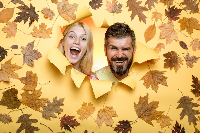 Funny couple getting ready for autumn sale. Joyful couple is happy with last warm days of autumn. Surprised couple on stock images