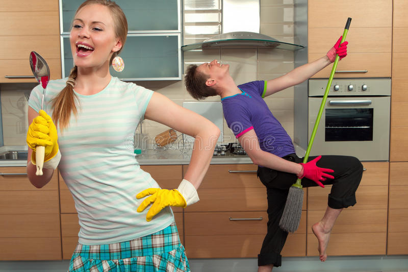 Funny couple on kitchen royalty free stock photography