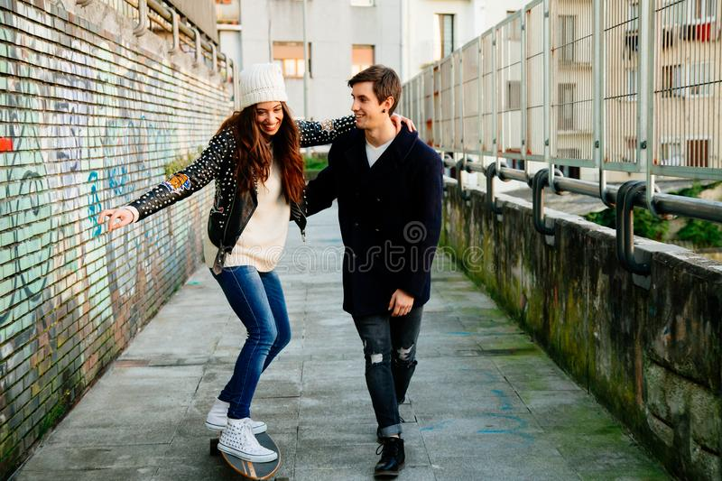 Funny couple learning to skate royalty free stock images