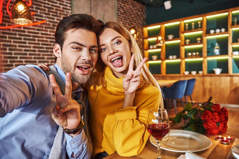 Funny couple making photo. Young couple making selfie royalty free stock images