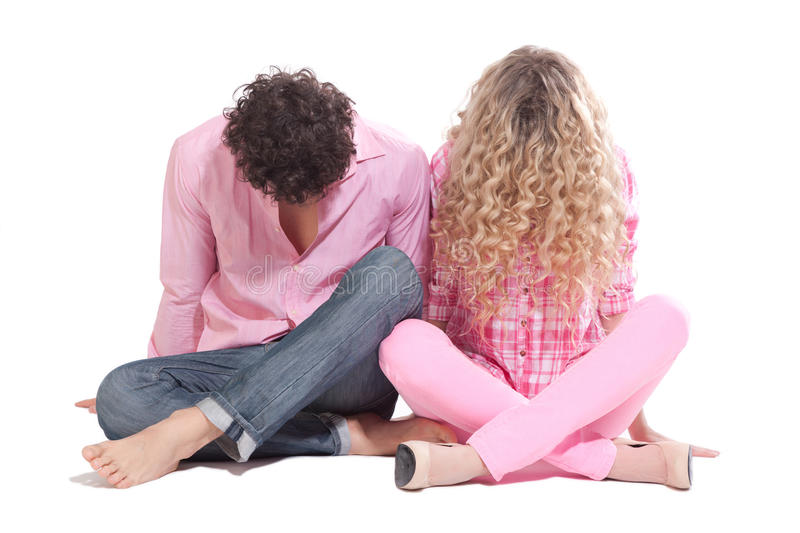 Funny couple sitting on the floor royalty free stock images