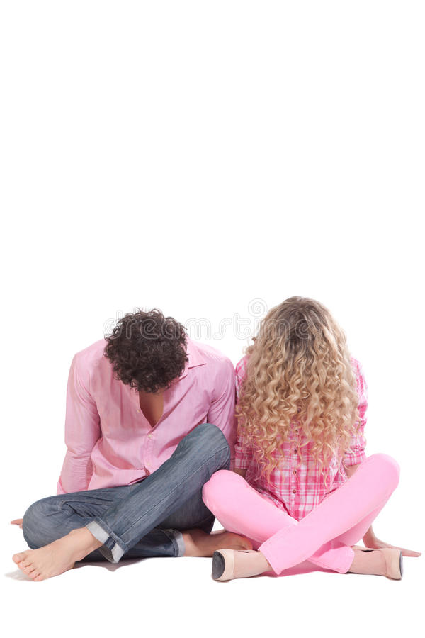 Funny Couple Sitting On The Floor In Studio Royalty Free Stock Images