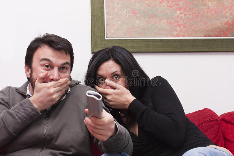 Funny Couple Watching Television