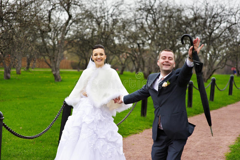 Funny couples in wedding walk. In park royalty free stock photos