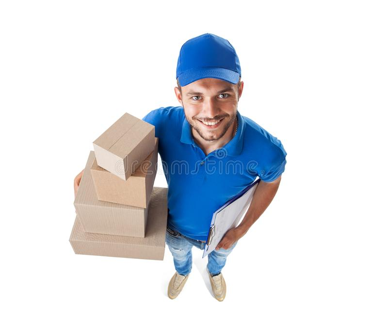 Funny courier with boxes looking at camera isolated on white background. Top view, fish eye lens shot stock photography
