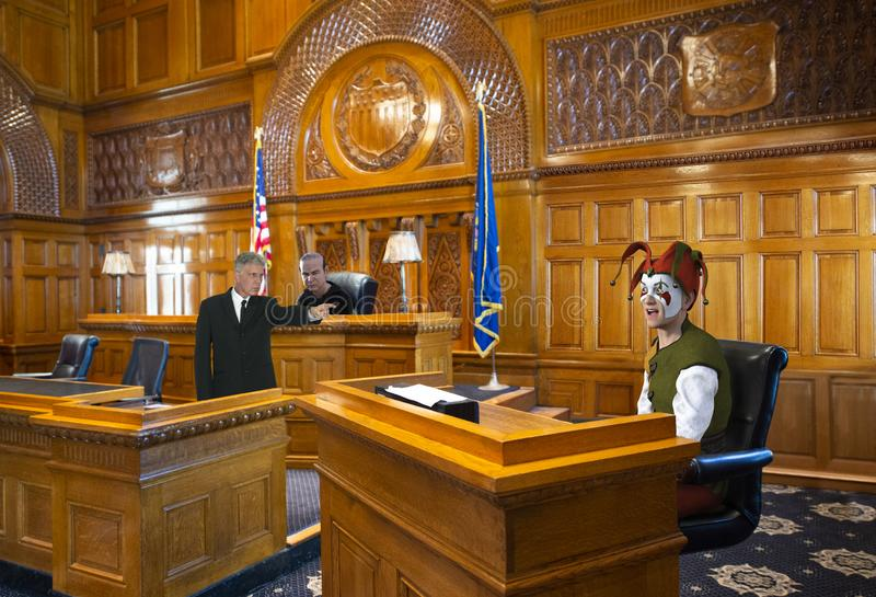 Funny Court Jester, Lawyer, Judge, Law. Fun and funny court jester is in a courtroom and on trial in front of a lawyer and judge. The clown is either guilty or royalty free stock photos