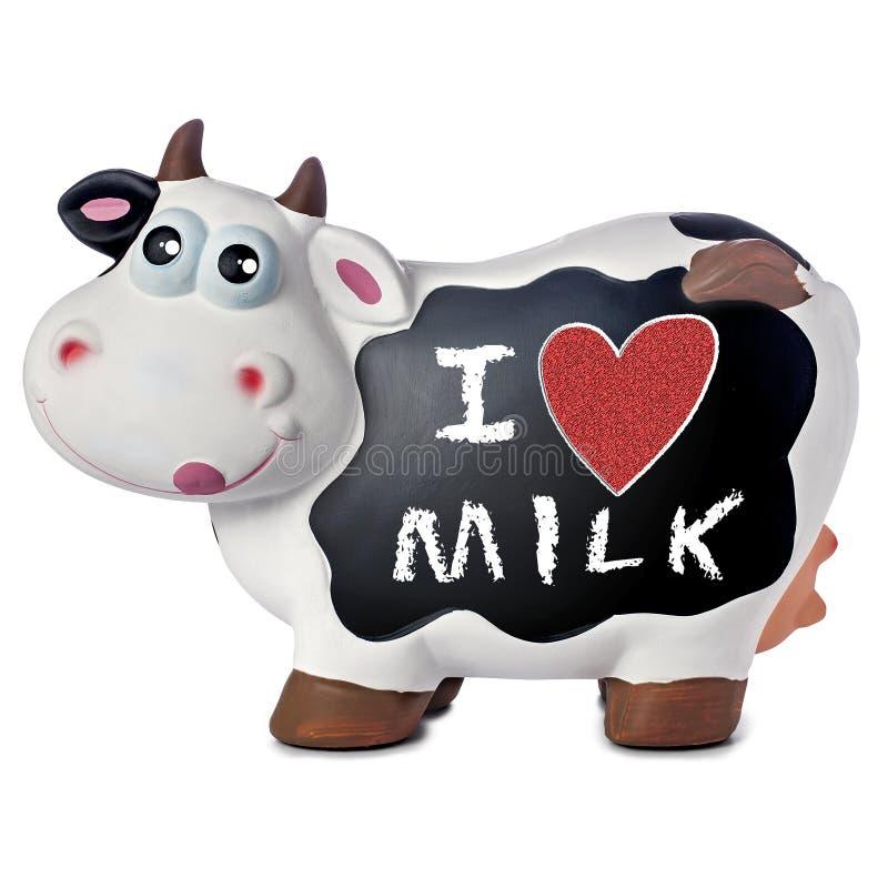 Funny Cow Blackboard Love Milk. Porcelain funny cow with I love milk handwritten on blackboard royalty free stock photo