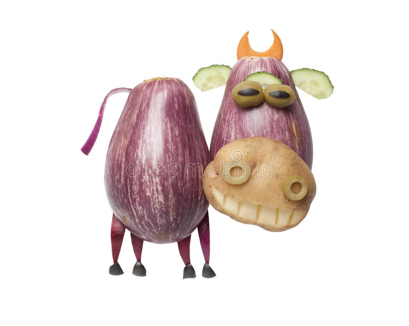 Funny cow made of eggplant and potato. On isolated background royalty free stock photo