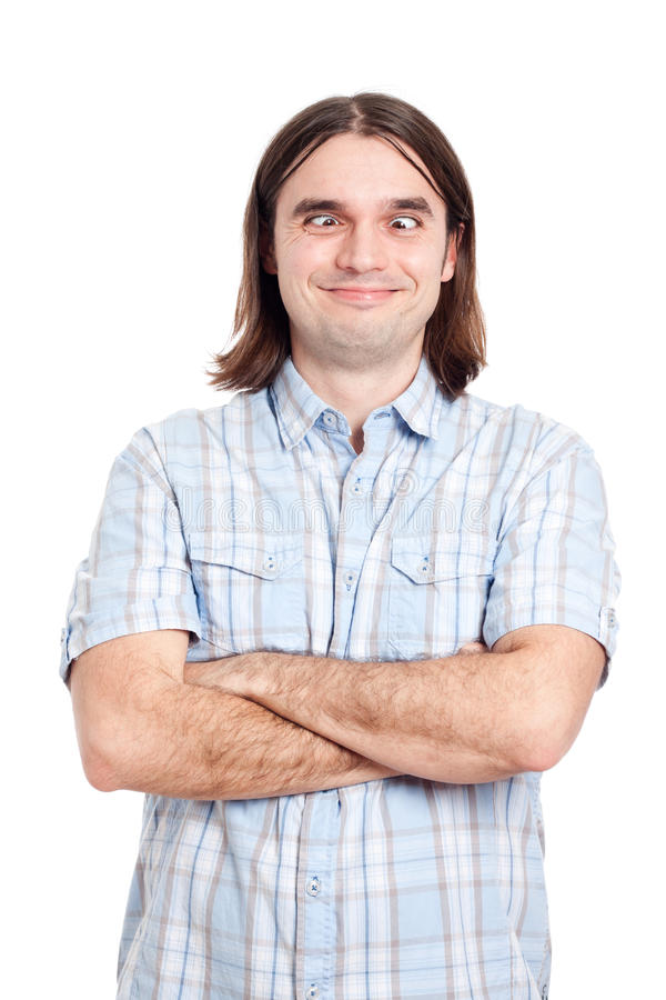 Funny crossed eyed man. Portrait of funny crossed eyed man making funny faces, isolated on white background stock image