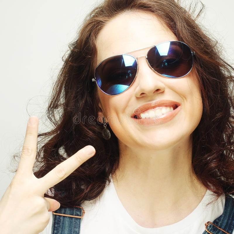 Curly woman with sunglasses. Funny curly woman with sunglasses, emotional picture royalty free stock photo