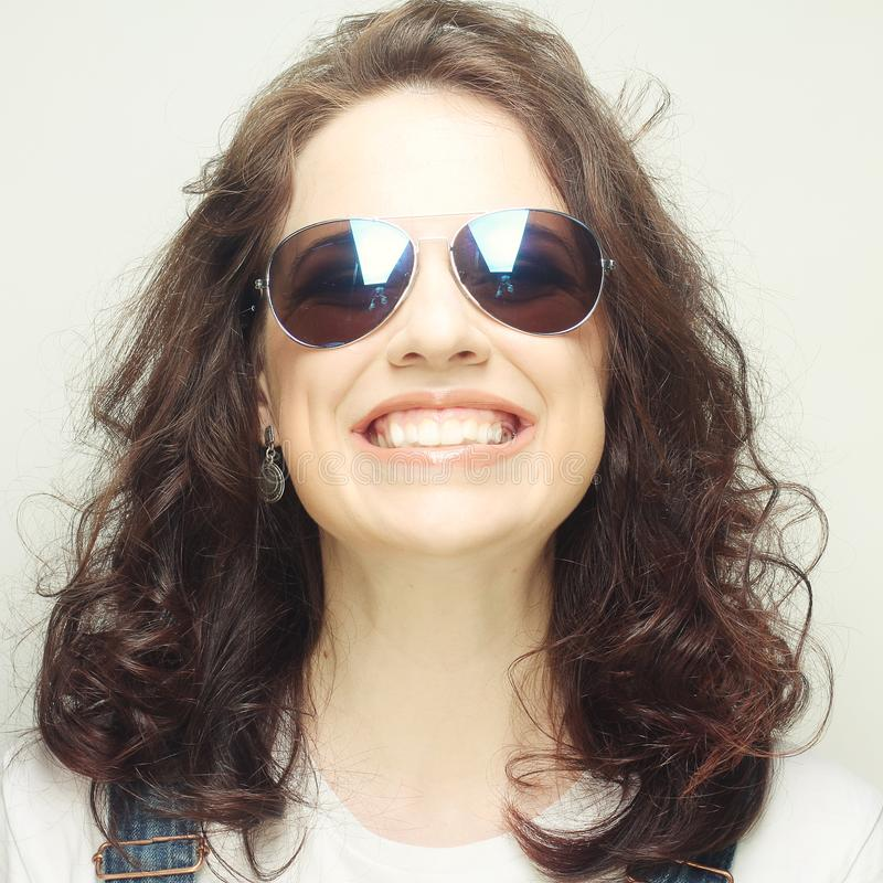 Curly woman with sunglasses. Funny curly woman with sunglasses, emotional picture royalty free stock photos