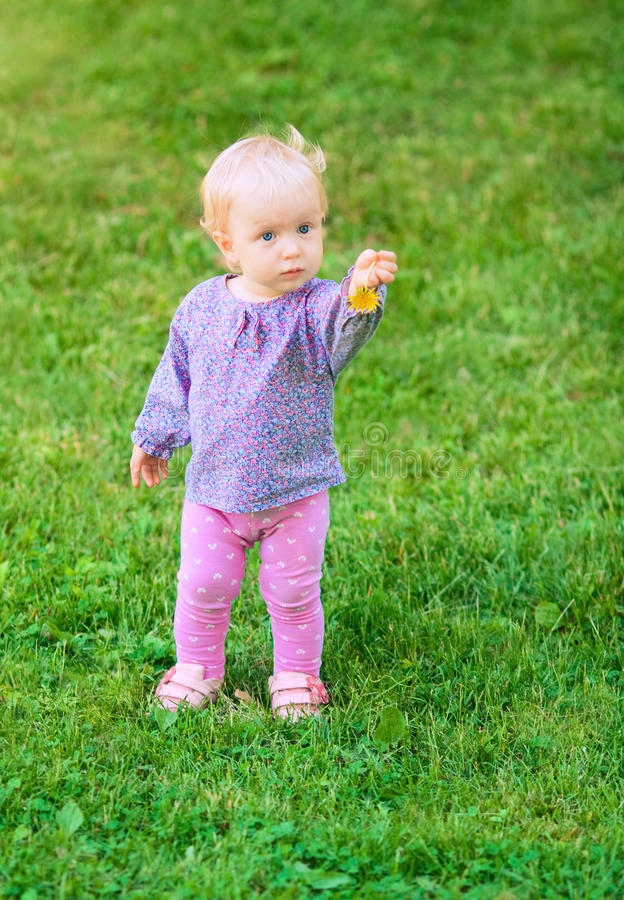 Funny cute baby girl with flower royalty free stock images