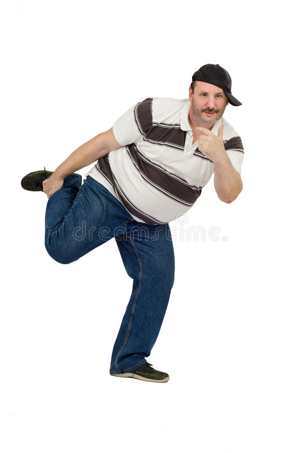 Funny dance of mature rapper. Funny dance of middle aged rapper on a white background stock images