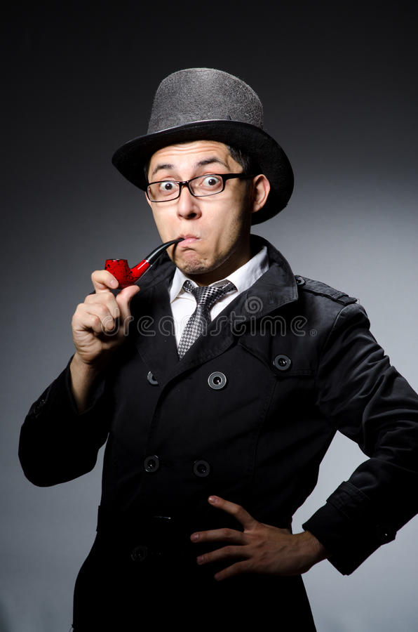 Funny detective with pipe. And hat royalty free stock images