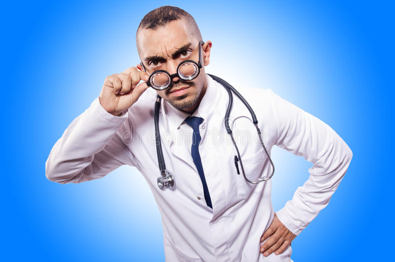Funny doctor. On the white stock photo