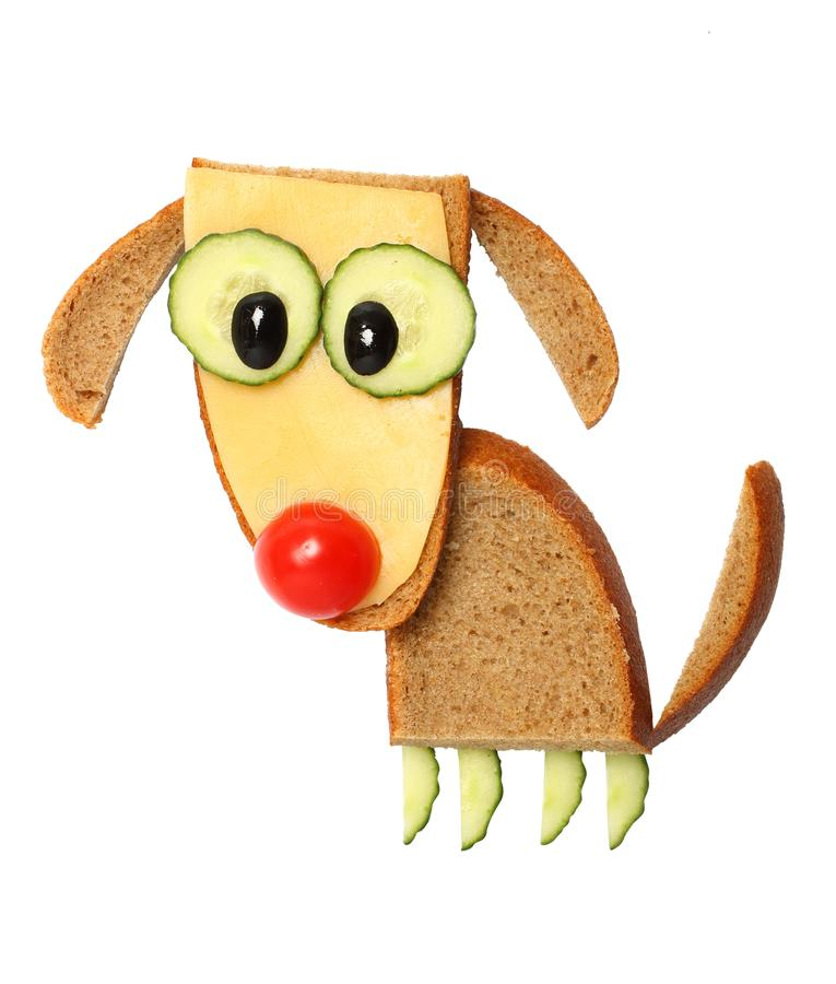 Funny dog made with bread, cheese and vegetables stock photos