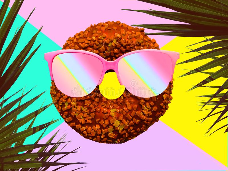 Funny donut in sunglasses on bright tropic background. Summer holidays and party theme. Funny donut in sunglasses on bright tropic background. Summer holidays stock image
