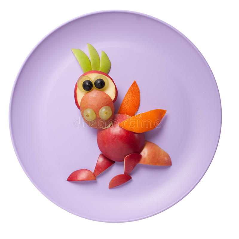 Funny dragon made of fruits stock image