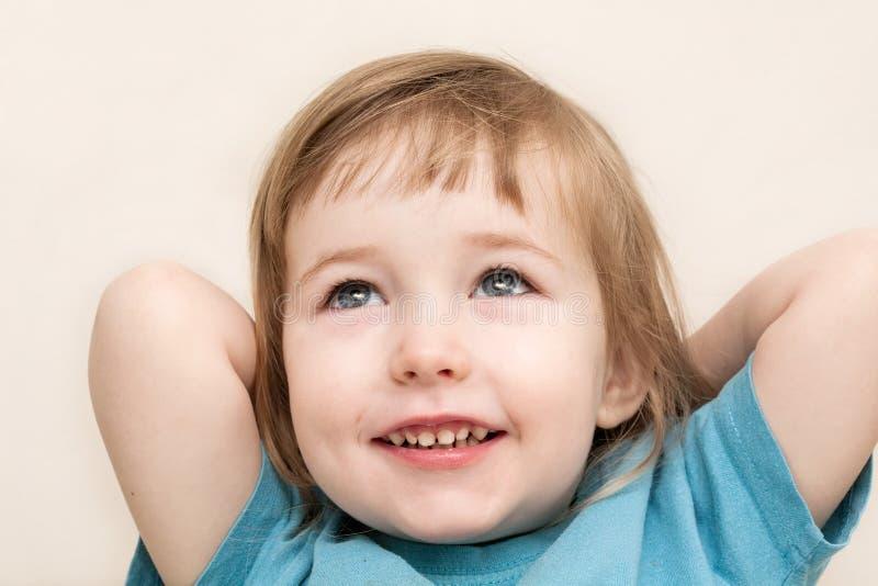 Funny dreamy emotional white child girl face closeup stock photos