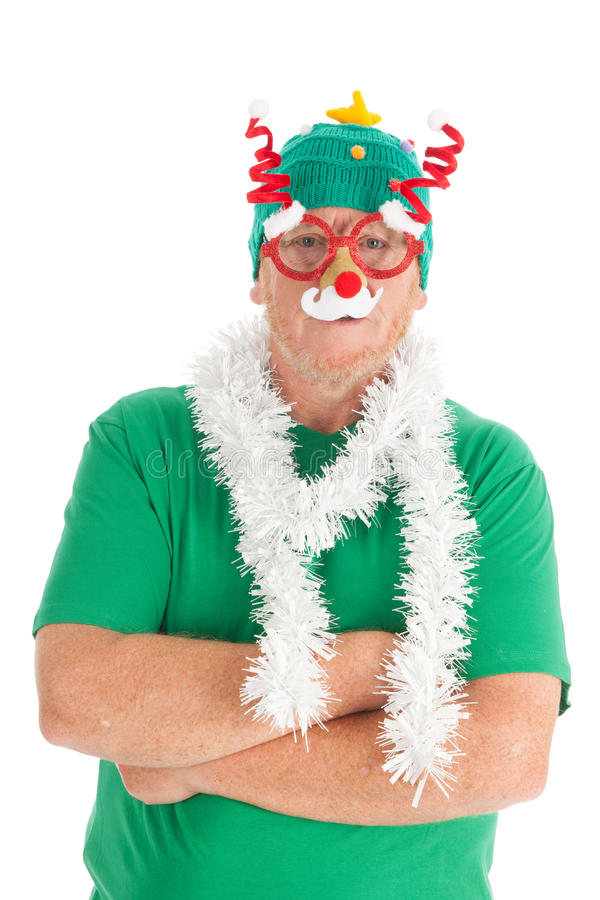 Funny dressed for Christmas. Man is funny dressed for the Christmas party stock photography