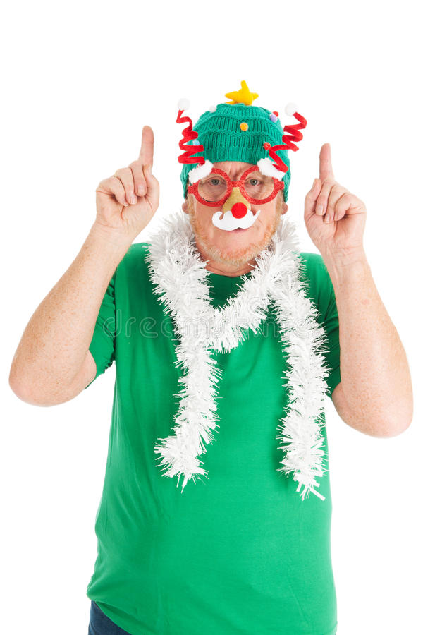 Funny dressed for Christmas. Man is funny dressed for the Christmas party royalty free stock photography