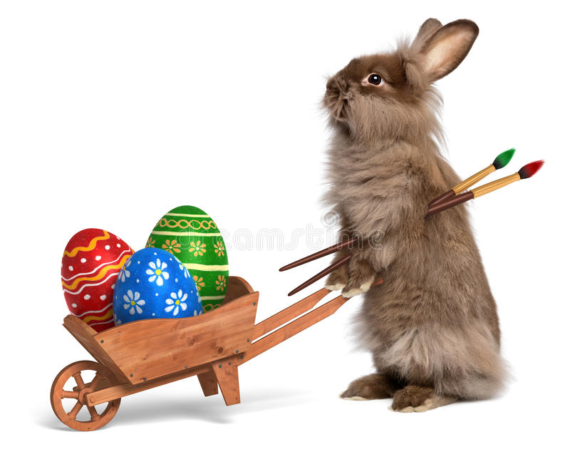 Funny Easter bunny rabbit with a wheelbarrow and some Easter egg. Cute Easter bunny rabbit with a little wheelbarrow and some painted Easter eggs, on white, CG+ stock photos