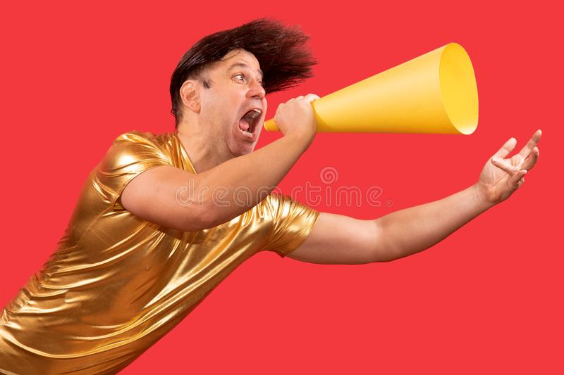 An funny eccentric man screaming to a megaphone royalty free stock image
