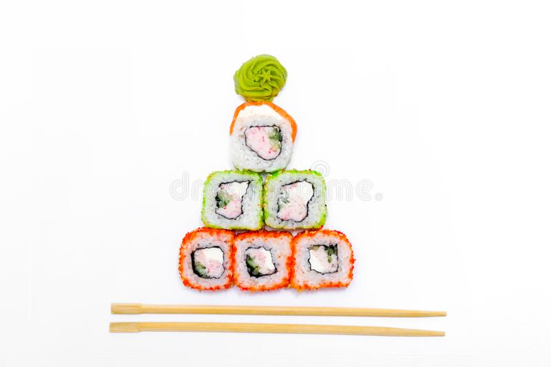 Funny edible Christmas tree made from sushi, creative idea for japanese restaurant on white background. New Year food stock images