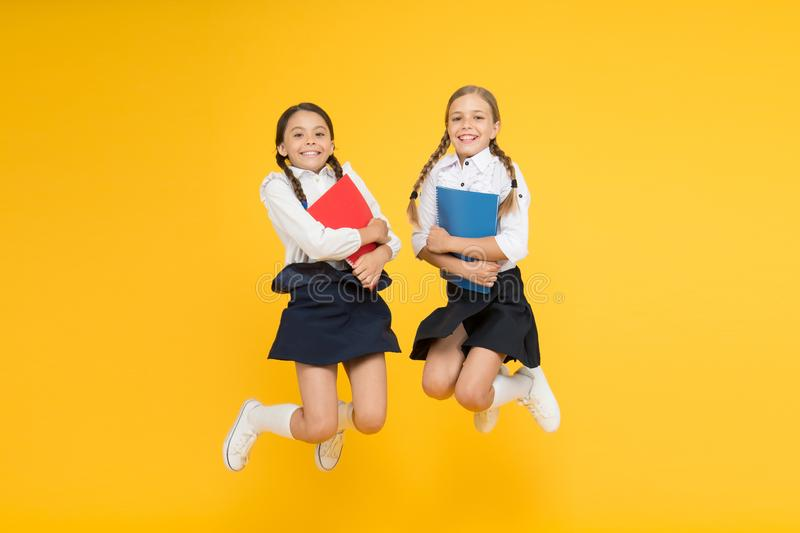Funny education. little girls in school uniform. cheerful classmates with workbook. kids learning grammar. back to. School. dictionary notebook. Get information royalty free stock image