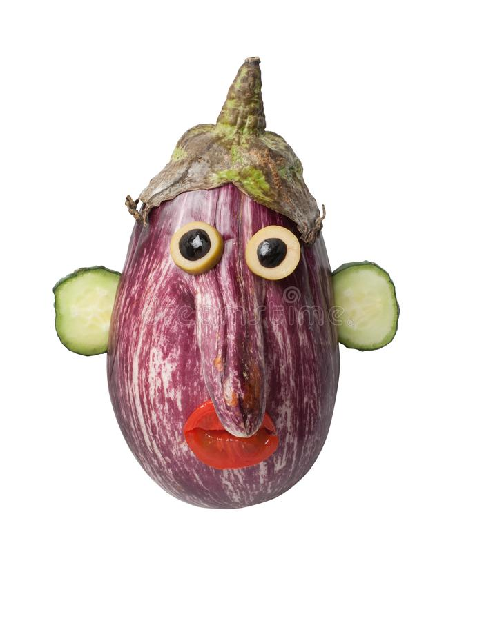 Funny eggplant face made on isolated background. Head made with eggplant, cucumber, tomato and olive. Easy way to make funny figures with simple ingridients royalty free stock photos