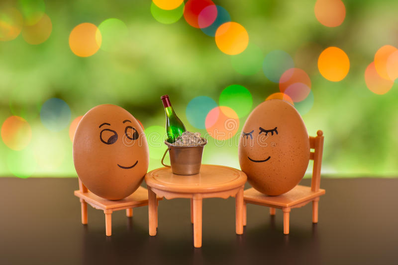 Funny eggs on a beach chair relaxing royalty free stock images