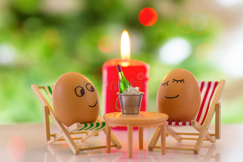 Funny eggs on a beach chair relaxing royalty free stock image
