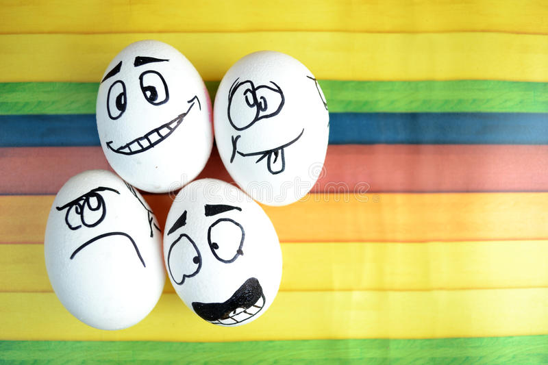 Funny eggs. Funny Easter eggs with different emotions on his face stock photo