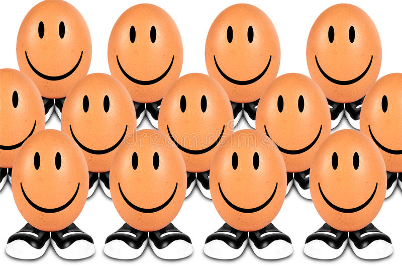 Funny eggs smiling stock photography