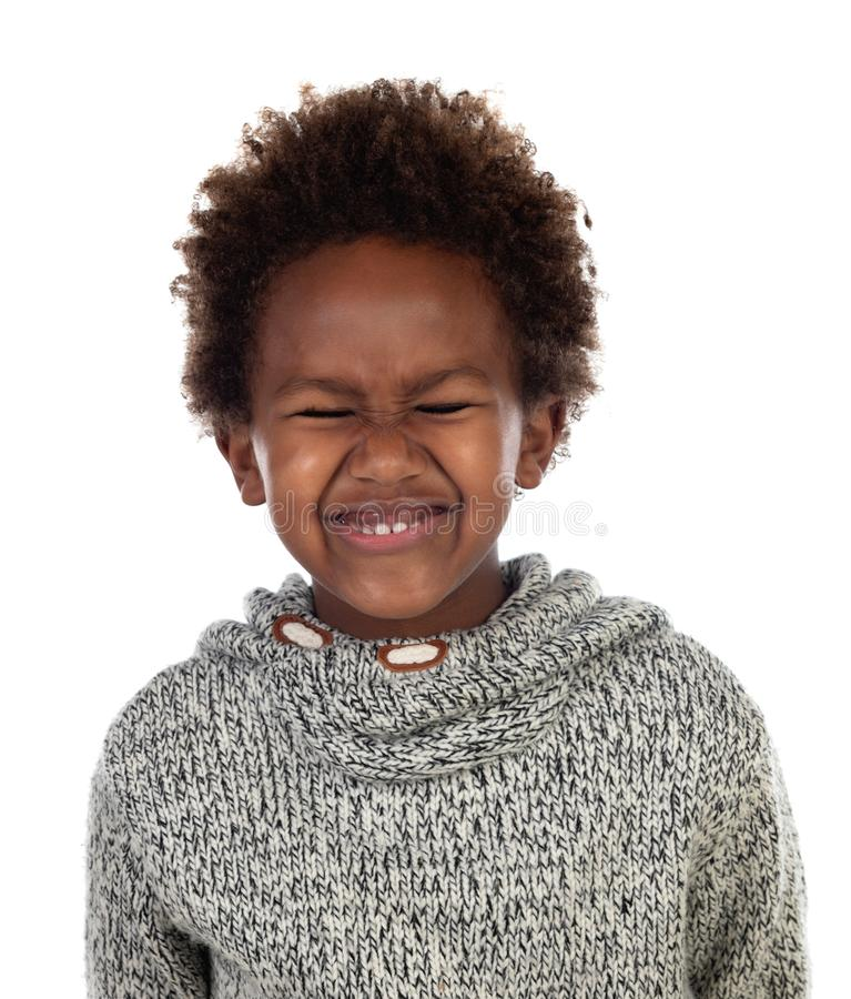 Funny expression of a small african child with clossed eyes royalty free stock photography