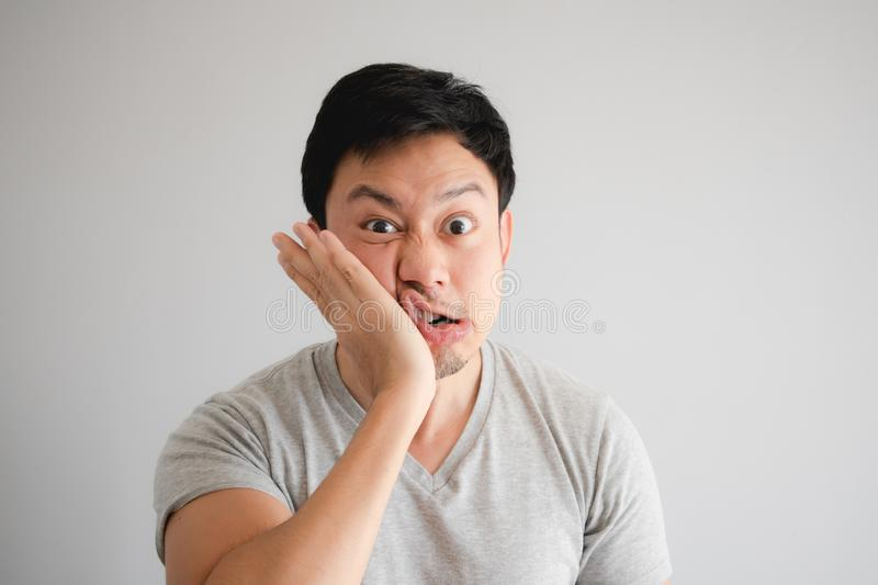 Funny face of angry man punish himself by hit on his own face royalty free stock photos