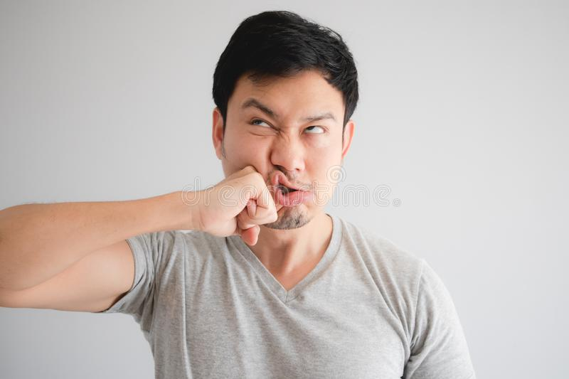 Funny face of angry man punish himself by hit on his own face stock photo